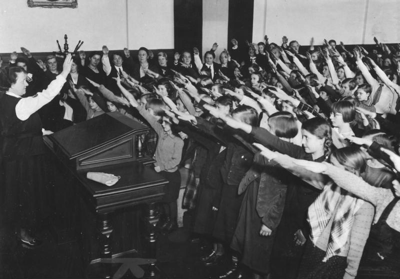 Large group of school children (around 10 years old) giving the Hitler salute in Berlin, Germany, 1934